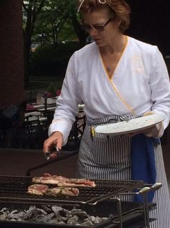Duck breasts are placed on the grill for our main course