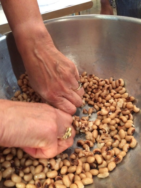 Black-eyed peas are hand crushed for the vegetable sausage mixture