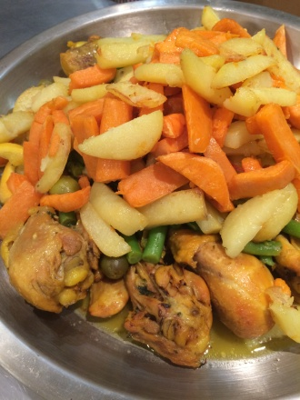 """Chicken tagine with green olives, green beans, and lemon, topped with """"french fries"""""""