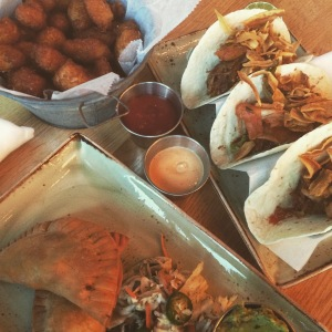 Tater tots, duck tacos, and pork belly empanadas